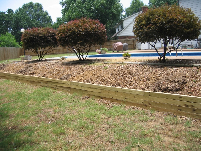 Wood retaining wall 2017 2018 best cars reviews for Cheap garden wall ideas